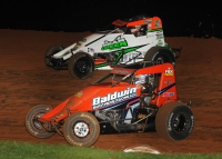 Eventual winner Chad Boespflug (white) and Chris Windom battle for the lead in the closing laps of Friday night's USAC AMSOIL Sprint Car National Championship feature at Bloomington (Ind.) Speedway.