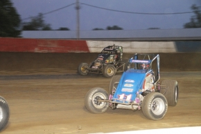 "Dave Darland (71P) takes the lead from Kevin Thomas, Jr. in Wednesday's ""Tony Hulman Classic"" at Terre Haute."