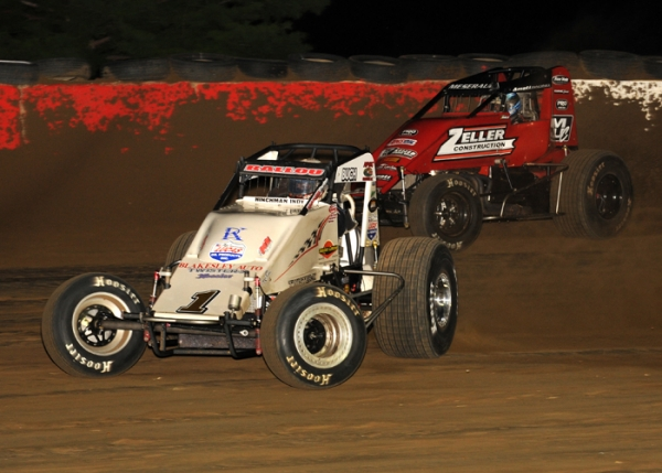 "#1 Robert Ballou passes Thomas Meseraull #66 for the lead on his way to a victory in the ""Tony Hulman Classic"" in May 2016 at the Terre Haute (Ind.) Action Track"