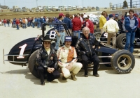 Sherman Armstrong poses with driver Greg Leffler and car builder Paul Leffler during the 1980 USAC National Sprint Car season.