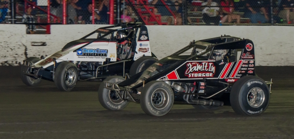 "Kevin Thomas, Jr. (in black) defeats Kyle Cummins to the line by 0.053 seconds to win Saturday night's USAC AMSOIL National/MSCS Sprint Car ""Haubstadt Hustler"" at Tri-State Speedway."