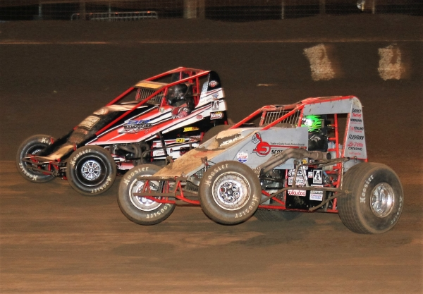 Damion Gardner, in silver, on his way to last Saturday night's USAC/CRA Sprint Car feature win at Perris.