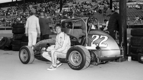 Tommy Astone poses with his USAC Midget ride at the Indiana State Fairgrounds on May 16, 1975