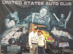 Buck and Betty Rice pose at the USAC booth at the recent PRI Show in Indianapolis.