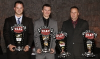 "USAC National Champions Robert Ballou, Kody Swanson and Tracy Hines pose after accepting their awards at Friday's USAC ""Night of Champions"" in Indianapolis, Ind."