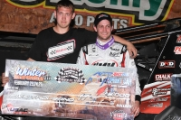 Winning crew chief Sam McGhee (left) and winning driver Justin Grant celebrate in victory lane after their win Friday night's USAC AMSOIL National Sprint Car season opener at Bubba Raceway Park in Ocala, Fla.