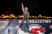 Chad Boespflug cage stands after winning Saturday night at Eldora.
