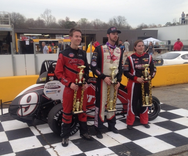 Runnerup Jake Nelke, winner Chris Lamb and third-place Jessica Bean pose on the podium at Anderson Motor Speedway.