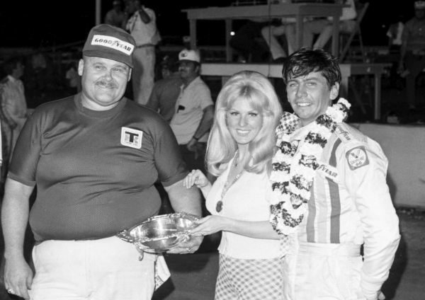 Billy Shuman celebrates a USAC National Sprint Car victory in 1973 at the Indiana State Fairgrounds.