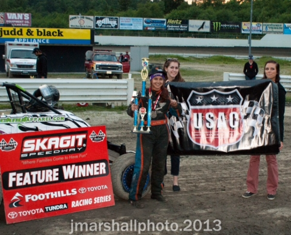 Ariel Biggs poses with the trophy after his first USAC win at Skagit.