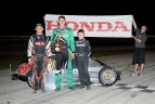 Cooper Clouse is joined by Wil Raber and Austin Nemire after Clouse;s win at Illiana.