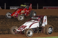 "Brent Beauchamp (inside) and Dave Darland (outside) battle side-by-side for the lead during Bloomington Speedway's ""Sheldon Kinser Memorial"" - Night #5 of Indiana Sprint Week"