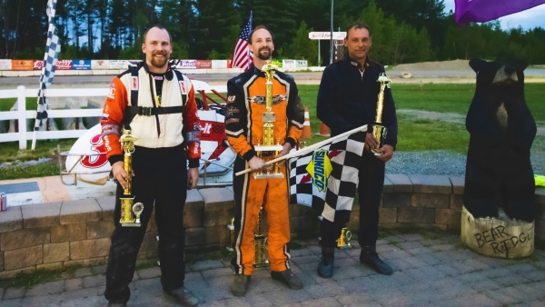 Winner Will Hull (middle) is joined in victory lane by 2nd place finisher Dean Christensen (right) and 3rd place finisher Joe Krawiec (left)/