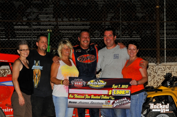 Charles Davis Jr. celebrates with his team at Queen Creek.