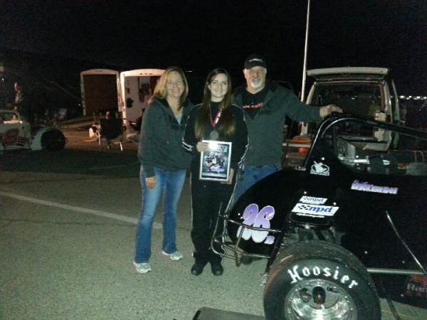 Christine Breckenridge poses with her parents after winning at LVMS.