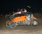 Kevin Thomas, Jr. (#17RW) makes the winning pass on the high side around race-long leader Robert Ballou (#5)...