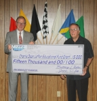 USAC Benevolent Foundation President Rollie Helmling (left) and its executive director, Bill Marvel, hold a check representing the $15,000 recently pledged to the Charlie Dean Leffler Educational Fund Grant by Delco Designs, LLC.