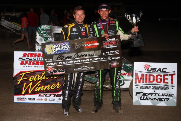 """40 for Shorty"" winner Bryan Clauson (right) stands in victory lane alongside fellow competitor Ricky Stenhouse, Jr., who finished 9th and was involved in the promotion of the weekend's events at Riverside International Speedway."