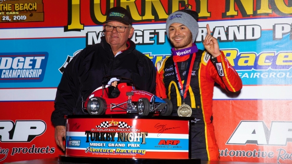 Kyle Larson (right) poses with Ventura Raceway promoter Jim Naylor following Friday night's Turkey Night Grand Prix victory.