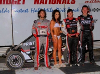 "Winner Chad Boat (second from right) is joined by 2nd place finisher Spencer Bayston (far right), 3rd place finisher Tanner Thorson and the trophy queen after winning Friday night's ""Belleville Midget Nationals"" opener."