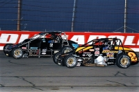 "Bobby Santos (left) battles Tanner Swanson for the lead in Thursday night's ""Rich Vogler/USAC Hall of Fame Classic"" at Lucas Oil Raceway."