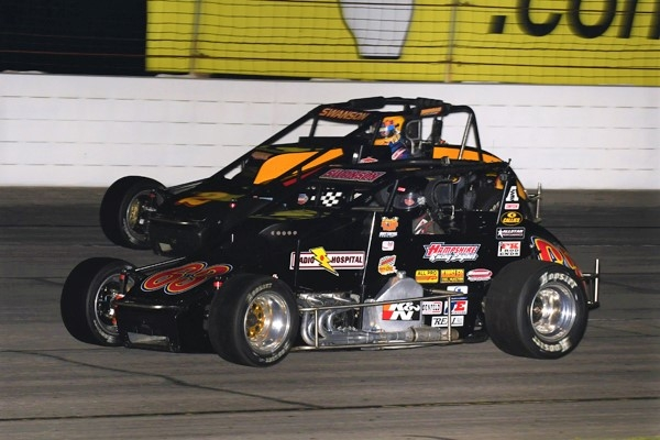 "Kody Swanson (in black) battles with brother Tanner Swanson on his way to his third-straight USAC Silver Crown victory in Friday night's ""Dave Steele Carb Night Classic"" at Lucas Oil Raceway at Indianapolis."