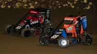 Eventual winner Emerson Axsom (#15) fights for the lead with a challenging Chris Windom (#89) alongside during the early laps of Friday's Kokomo Grand Prix.
