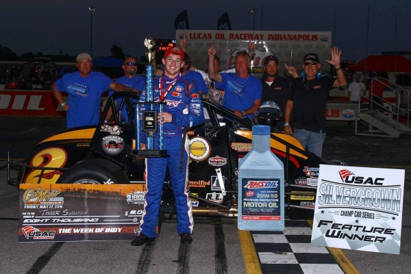 "Tanner Swanson celebrates in victory lane after winning Friday night's ""Carb Nigh Classic"" at Lucas Oil Raceway in Brownsburg, Indiana."